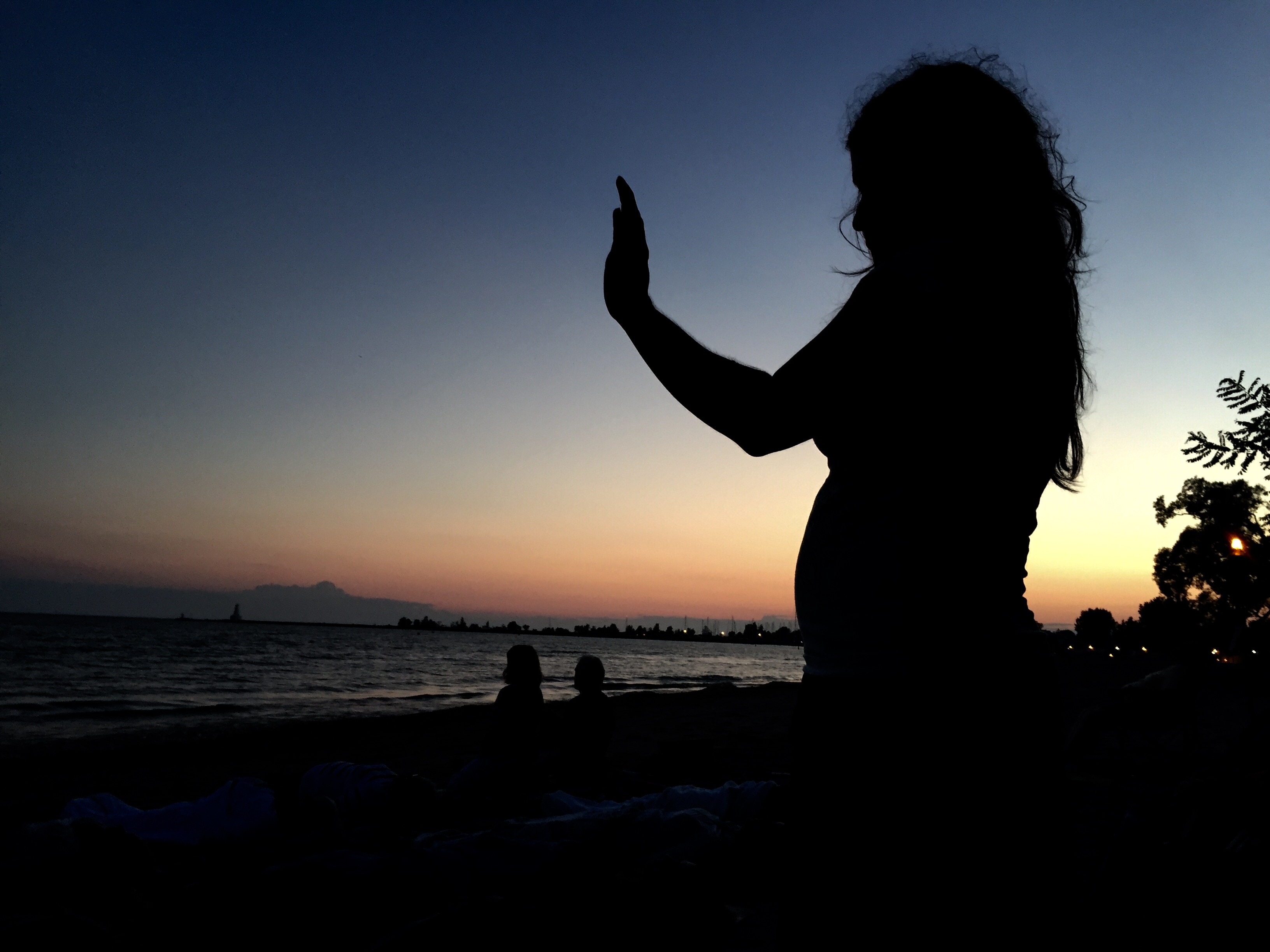 Kimmie McBride of Organic Spirit leading a group full moon meditation on the beach at Lake House.